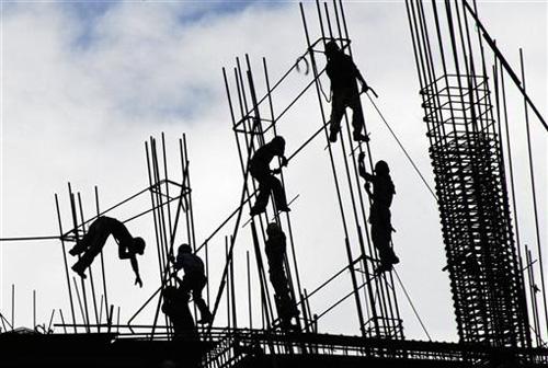 Одобрен закон о медицинском страховании трудовых мигрантов